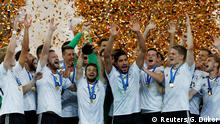 Soccer Football - Chile v Germany - FIFA Confederations Cup Russia 2017 - Final - Saint Petersburg Stadium, St. Petersburg, Russia - July 2, 2017 Germany celebrate with the trophy after winning the FIFA Confederations Cup REUTERS/Grigory Dukor