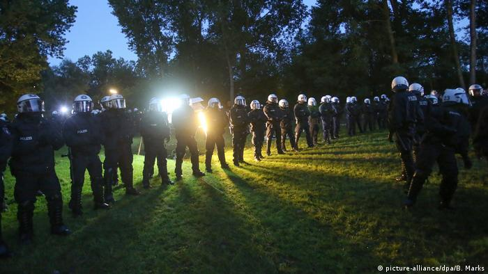 Police move in on July 2 to confiscate tents from a banned camp in Hamburg's Entenwerder park