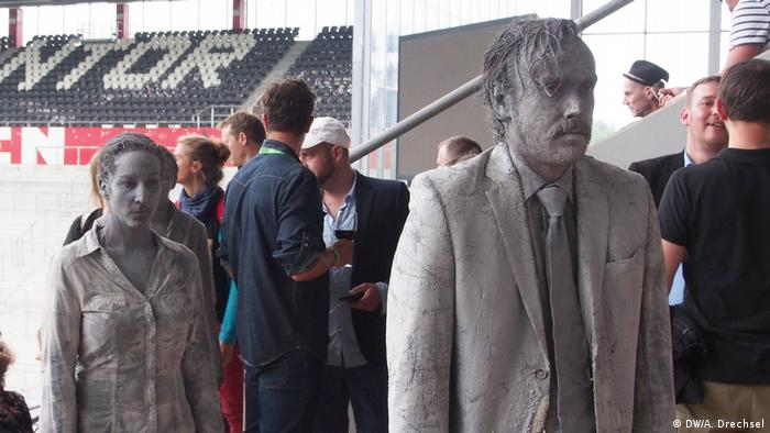 Zombie figures wander through the streets of Hamburg as part of an art installation