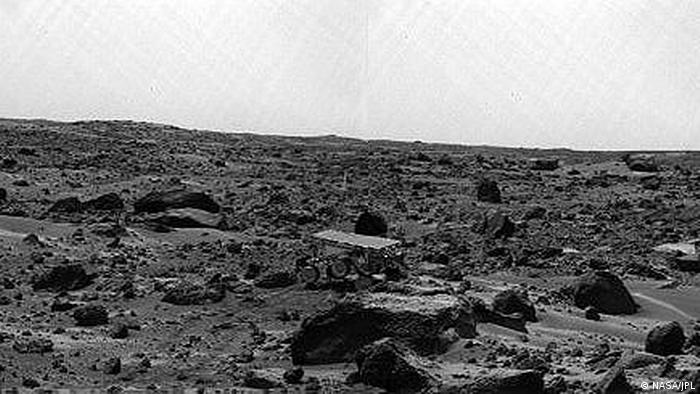 Sojourner on Mars amid rocky landscape