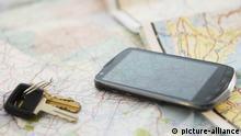 Autoschlüssel und Smartphone