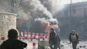 Afghan security run after a suicide attack in Kabul, Afghanistan on Saturday