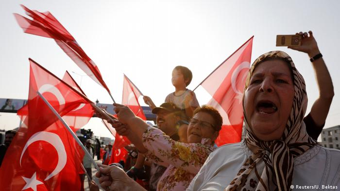 Supporters of Turkey's main opposition Republican People's Party (CHP) leader Kemal Kilicdaroglu wave Turkish flags on the 19th day of a protest