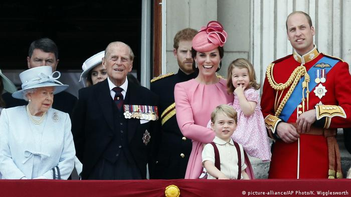 Members of the British royal family with from left, Queen Elizabeth II, Prince Philip, Prince Harry, Princess Kate, The Duchess of Cambridge, with children Prince George and Princess Charlotte, Prince William, gather on the balcony of Buckingham Palace