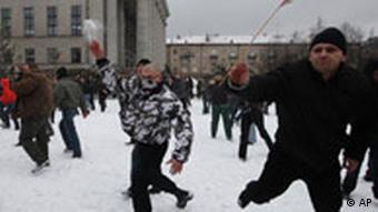 Protestors attack riot police