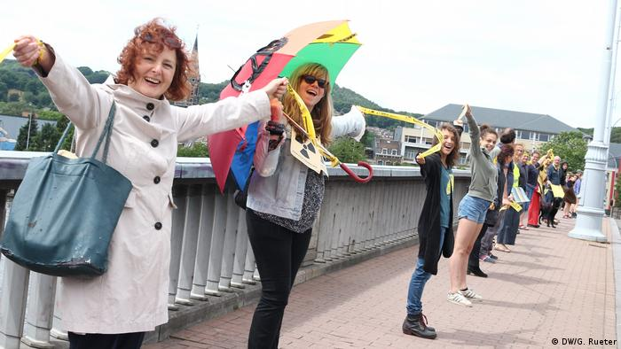 People holding hands in protest against Belgium nuclear power plants