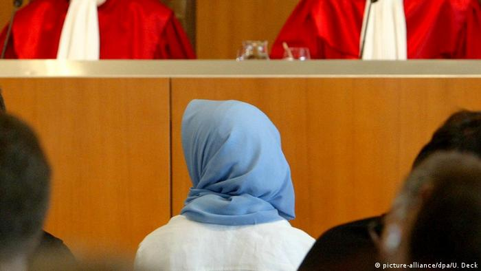 Woman with headscarf sitting in court