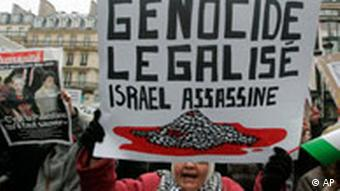 Protesters in Paris carry a sign reading Legalized Genocide, Israel Murders