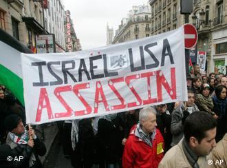Protestors march during a pro-Palestinian demonstration against the Israeli offensive in the Gaza Strip on Jan. 17, 2009, in Paris. The banner reads Israel, USA, Murderers