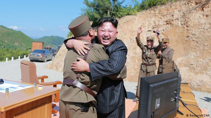 North Korean leader Kim Jong Un celebrating a missile launch in July