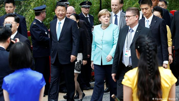 German Chancellor Angela Merkel and Chinese President Xi Jinping arrive for a welcome ceremony for Chinese panda bears (Reuters/F. Bensch)