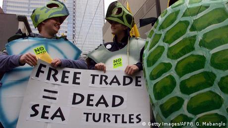 WTO protesters in sea turtle customes (Getty Images/AFP/J. G. Mabanglo)