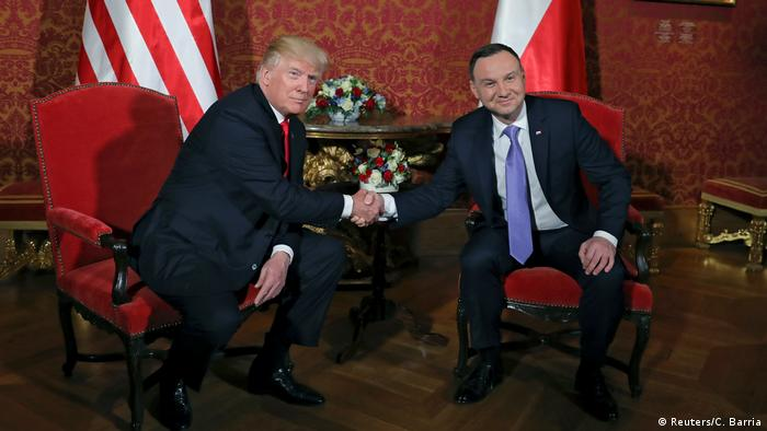 Polish President Andrzej Duda welcomes Donald Trump during state visit in July 2017 (Reuters/C. Barria)