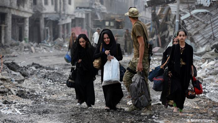 Fleeing civilians (Reuters/Stringer )