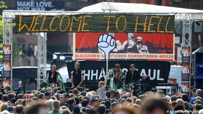 A band plays for the people protesting during the G20 summit in Hamburg