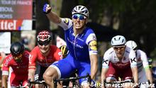 Germany's Marcel Kittel celebrates as he crosses the finish line ahead of France's Nacer Bouhanni (L), Germany's Andre Greipel (2ndL) and Norway's Alexander Kristoff (R) during the 216 km sixth stage of the 104th edition of the Tour de France cycling race on July 6, 2017 between Vesoul and Troyes. / AFP PHOTO / PHILIPPE LOPEZ (Photo credit should read PHILIPPE LOPEZ/AFP/Getty Images)