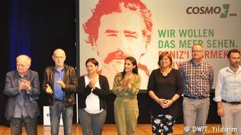 Πρόσφατη εκδήλωση αλληλεγγύης προς τον δημοσιογράφο Ντενίζ Γιουτζέλ στη Γερμανία