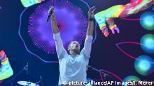 06.07.2017******Singer Chris Martin, of the band Coldplay, performs at the Global Citizen Festival concert on the eve of the G-20 summit in Hamburg, northern Germany, Thursday, July 6, 2017. The leaders of the group of 20 meet July 7 and 8. (AP Photo/Jens Meyer)  