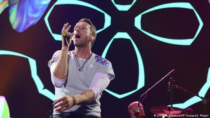 Chris Martin, coldplay, a male singer on stage with a microphone