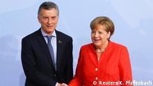 07.07.2017+++ German Chancellor Angela Merkel greets Argentina's President Mauricio Macri as he arrives for the G20 leaders summit in Hamburg, Germany July 7, 2017. REUTERS/Kai Pfaffenbach