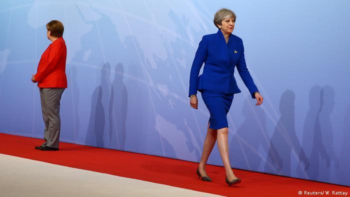 G20 Angela Merkel and Theresa May