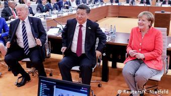 Дональд Трамп, Си Цзиньпин и Ангела Меркель на саммите G20 в Гамбурге в 2017 году