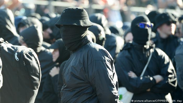 Protesters, all dressed in black, at a G-20 Summit in Hamburg
