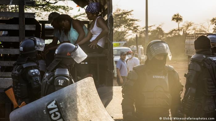 Colombia police evicting a local community