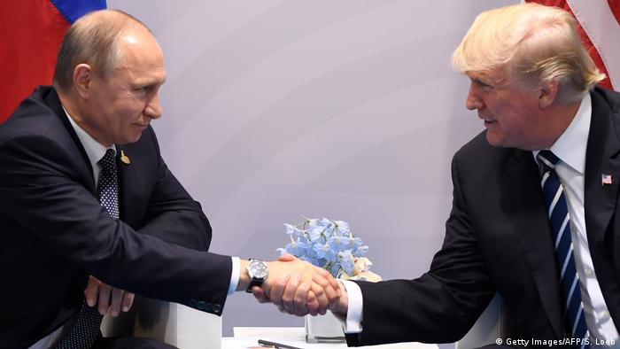 Vladimir Putin and Donald Trump shaking hands in Hamburg.