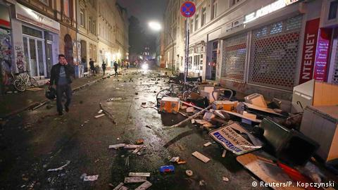 A Hamburg street showing damaged furniture and debris after protests