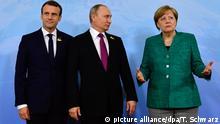 G20-Gipfel Gespräch Merkel Putin Macron