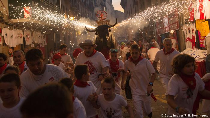 ... the famous running of the bulls at the San Fermin festival, where ten people were hurt during the bull running. One man was caught on the horns of a bull, being dragged several meters before being trampled on a bend along the course. Here, a Toro del Fuego is run through the streets of Pamplona.
