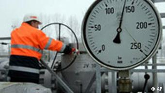 In a Jan. 8, 2009 file photo a worker moves a valve of a gas pipeline in a gas storage plant in Gronau, western Germany, near the Dutch border.