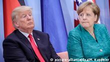 08.07.2017 *** Donald Trump, Präsident der USA und Bundeskanzlerin Angela Merkel (CDU) nehmen am 08.07.2017 an einer Paneldiskussion Launch Event Women's Entrepreneur Finance Initiative beim G20-Gipfel in Hamburg teil. Am 07. und 08. Juli kommen in der Hansestadt die Regierungschefs der führenden Industrienationen zum G20-Gipfel zusammen. Foto: Michael Kappeler/dpa | Verwendung weltweit