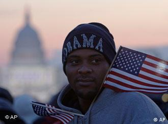 Sean Scott of Bridgeport, Conn., waits on the National Mall in Washington, Tuesday, Jan. 20, 2009, for the swearing-in of President-elect Barack Obama