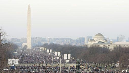 Crowds fill the National Mall as they wait for the inauguration ceremony to begin at in Washington