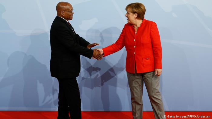 German Chancellor Angela Merkel shakes hands with former South African President Jacob Zuma
