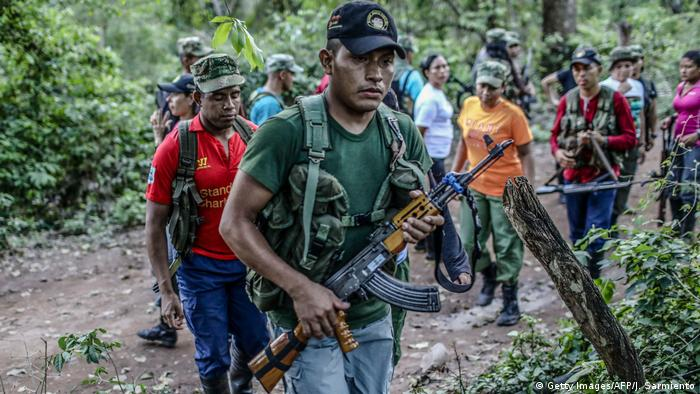FARC rebels march through the jungle