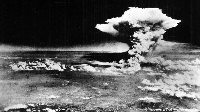 The atomic bomb explodes over Hiroshima