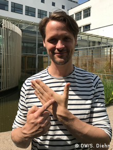 Hannes Sjoblad points to the spot on his hand where he had a microchip implanted