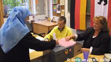 Muslim woman voting
