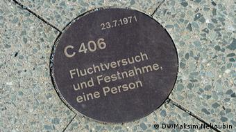 A round commemorative plaque at the Berlin Wall Memorial