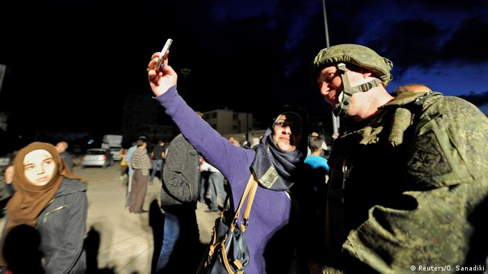 Selfies on war (Reuters/O. Sanadiki)