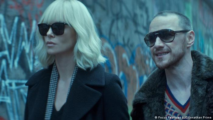 Film still from Atomic Blonde with Charlize Theron and James McAvoy next to the Berlin Wall (2017) (Focus Features LLC./Jonathan Prime)