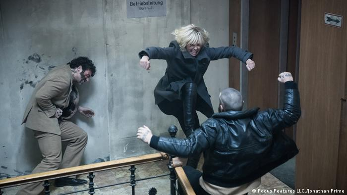 Film still from Atomic Blonde with Charlize Theron fighting two men (2017) (Focus Features LLC./Jonathan Prime)