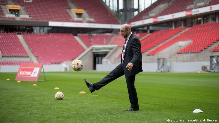 Martin Schulz kicking a ball in the Cologne football stadium