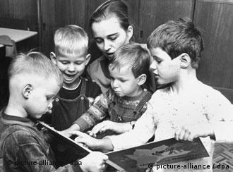 A foster mother reads to children