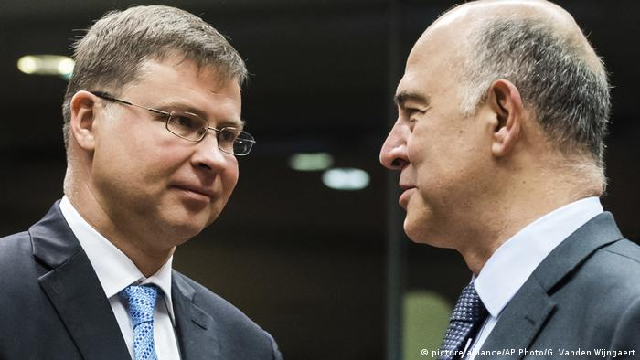 Valdis Dombrovskis, Pierre Moscovici (picture alliance/AP Photo/G. Vanden Wijngaert)