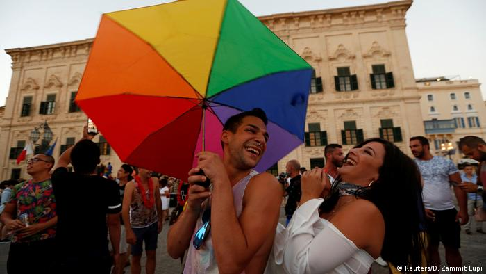 Gay marriage supporters celebrate outside Malta's parliament after the Marriage Equality Bill passed.