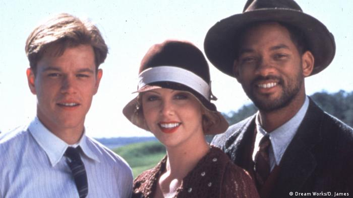 Charlize Theron mit Will Smith und Matt Damon in Die Legende von Bagger Vance von 2000 (Dream Works/D. James )